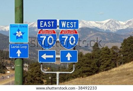Colorado Interstate 70 road signs and mountains - stock photo