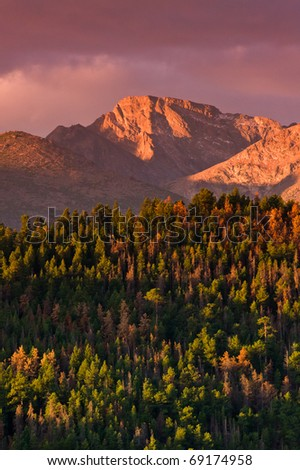 Colorado's famous Longs Peak bathed in Alpenglow of the morning sunrise - stock photo