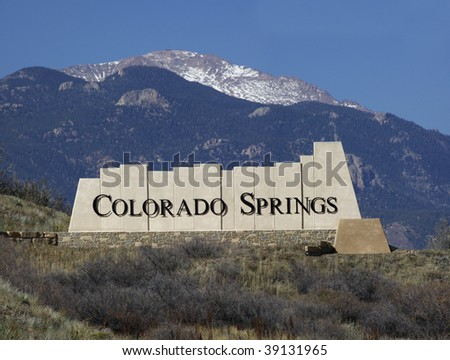 Colorado Springs city entry monument with Pikes Peak in the background