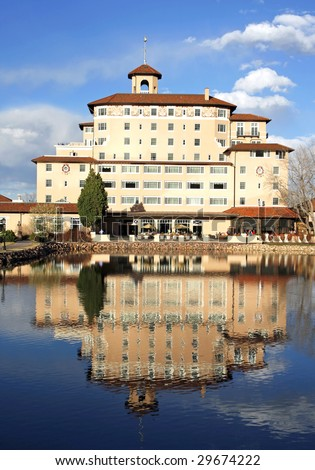 COLORADO SPRINGS, CO - APRIL 22:  A rear view of the famous Broadmoor Hotel main wing April 22, 2009 in Colorado Springs. The historic resort has served many USA Presidents, athletes and celebrities. - stock photo