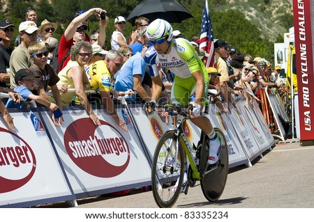 COLORADO SPRINGS, CO - AUG 22: Professional cyclist  Davide Cimolai rides the prologue course of the 2011 USA Pro Cycling Challenge in Colorado Springs, USA on Aug 22, 2011 - stock photo