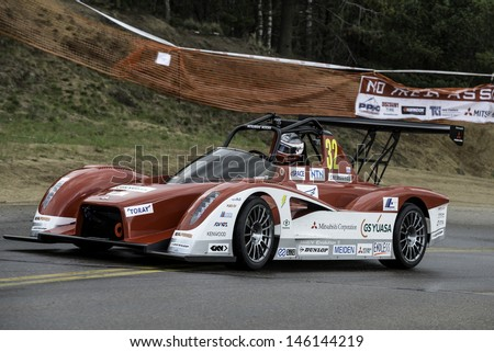COLORADO SPRINGS, CO - JUNE 30: Hiroshi Masuoka #32 drives a Mitsubishi MiEV Evolution II to 2nd in the Electric Class at the Pikes Peak International Hill Climb on June 30, 2013 in Colorado Springs. - stock photo