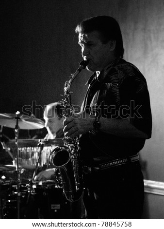 COLORADO SPRINGS, CO. USA – APRIL 8:	Saxophonist Chuck Frazier of the Acoustic Rock band Andy Clifton & Co. performs in concert April 8, 2006 at the Antlers Ballroom in Colorado Springs, CO. USA