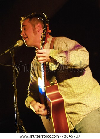 COLORADO SPRINGS, CO. USA – APRIL 8:	Vocalist/Guitarist Andy Clifton of the Acoustic Rock band Andy Clifton & Co. performs in concert April 8, 2006 at the Antlers Ballroom in Colorado Springs, CO. USA