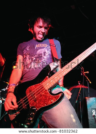 COLORADO SPRINGS, CO. USA – JULY 6:	Bassist Keith Kutach of the Heavy Metal band Aesthetic Delirium performs in concert on July 6, 2010 at the Black Sheep Theater in Colorado Springs, CO. USA