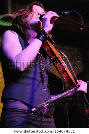 COLORADO SPRINGS		DECEMBER 13:		Folk Artist Tania Elizabeth performs in concert December 13, 2011 at The Loft music hall in Colorado Springs CO. - stock photo