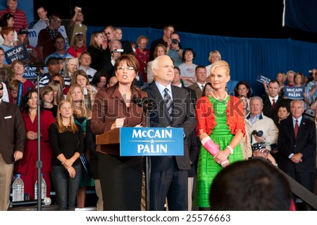 COLORADO SPRINGS - SEPTEMBER 6, 2008: John McCain and Sarah Palin speak to the crowd at a rally in Colorado on September 6, 2008. - stock photo