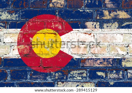 Colorado state flag of America on brick wall - stock photo