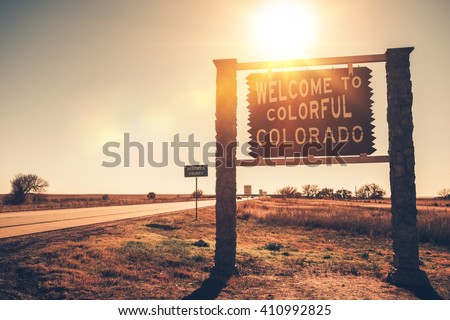Colorado State Welcome Wooden Sign on a Side of the Highway. Colorado, USA. - stock photo