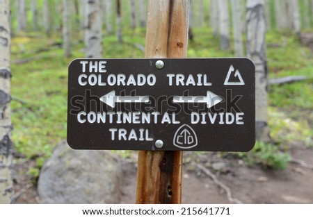 Colorado Trail hiking sign in forest - stock photo