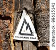 Colorado Trail marker on a tree along the trail. - stock photo