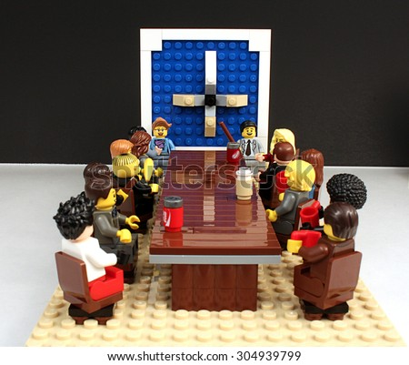 Colorado, USA - June 27, 2015: Studio shot of Lego minifigures portraying board meeting scene on white background. - stock photo