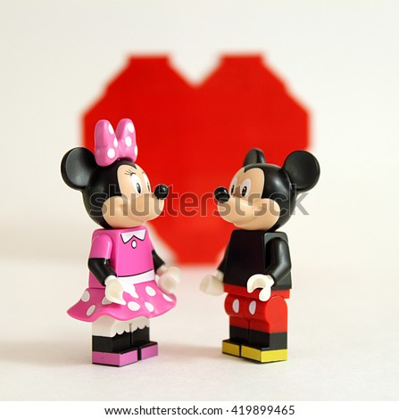Colorado, USA - May 13, 2016: Studio shot of LEGO minifigure Mickey Mouse and Minnie Mouse in love with heart in background.   - stock photo