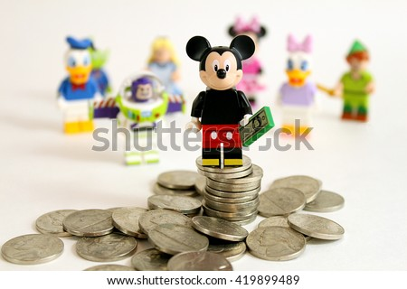 Colorado, USA - May 13, 2016: Studio shot of LEGO minifigure Mickey Mouse on top of a pile of money with other Disney characters in the background. Photo isolated on white.  - stock photo