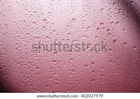 Colored abstract pattern of water drop on pink background:Close up,select focus with shallow depth of field:ideal use for background. - stock photo