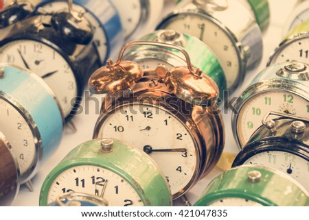Colored alarm clocks, background. Toned - stock photo