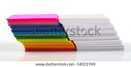 Colored and white paper stack isolated on white background - stock photo