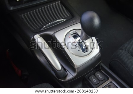 Colored automatic gearshift stick with parking brake - stock photo