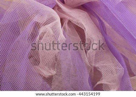 Colored backgrounds with tulle fabric textured wallpaper.