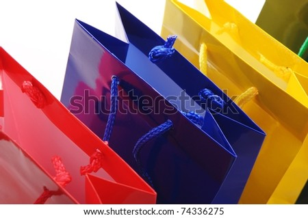 colored bags for shopping isolated on white background - stock photo
