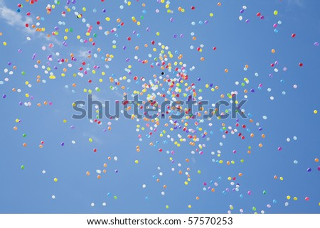 Colored balloons in the blue sky - stock photo