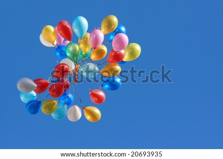 Colored balloons isolated on blue. - stock photo