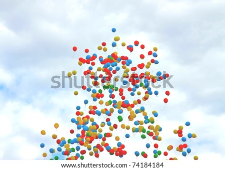 Colored balloons on sky to background - stock photo
