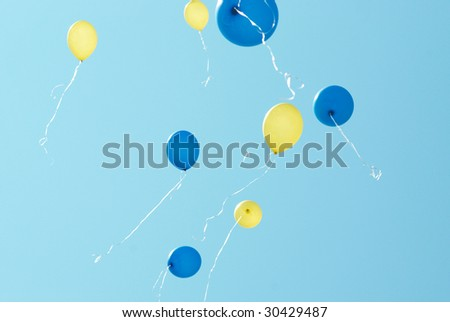 Colored balloons on the blue sky background - stock photo