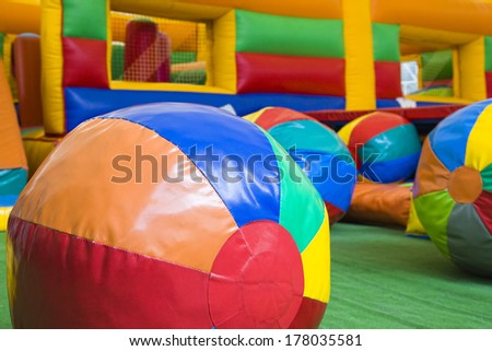 Colored balls and toys in a children play center - stock photo