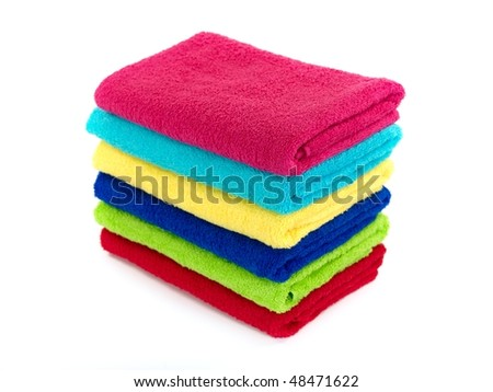 Colored bathroom towels isolated against a white background - stock photo