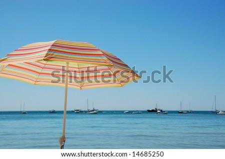 Colored beach umbrella - stock photo