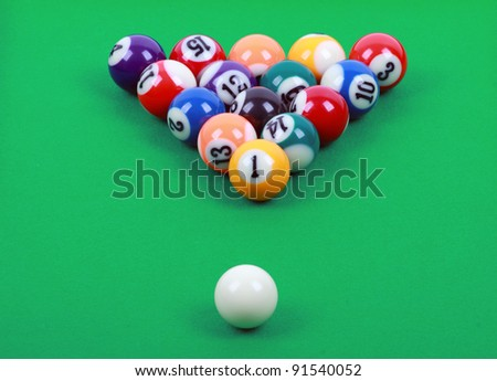 colored billiard balls on green table