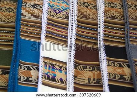 Colored blankets for Sale in Salar of Uyuni tourist market. Bolivia - stock photo