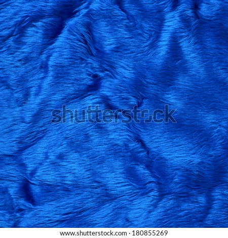 Colored blue faux fur texture background fragment - stock photo