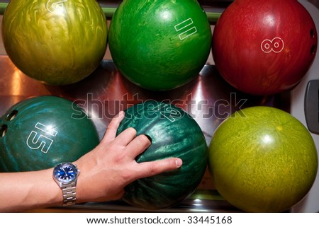 Colored bowling balls in the tray - stock photo