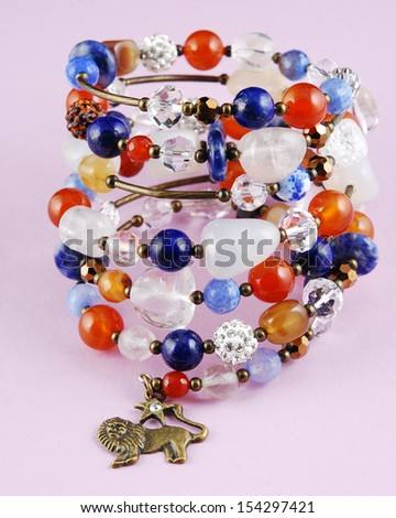 Colored bracelet on string - stock photo