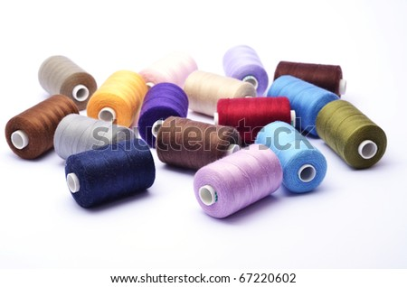 Colored bunch of sewing rolls on white background - stock photo