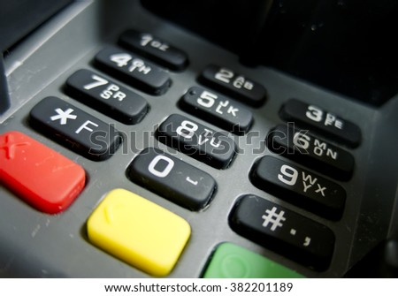 Colored buttons and numbers to the unit receiving cashless payments - stock photo