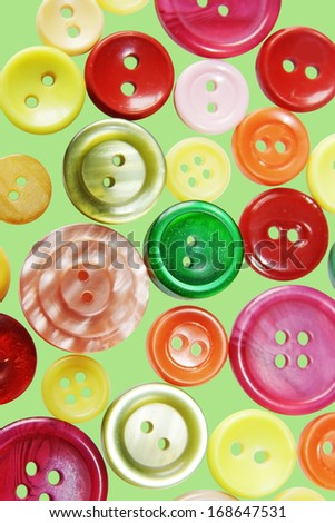 Colored buttons on green background