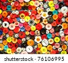 Colored buttons on their clothes - stock photo