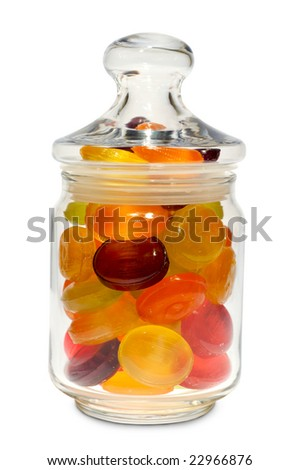 Colored candy in glass jars with lids, isolated on a white background.