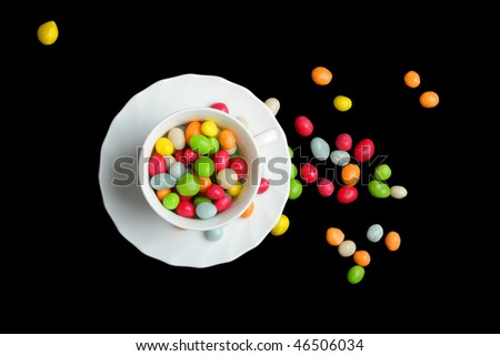 colored candy on black (more candy in my portfolio) - stock photo