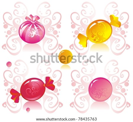 Colored candy on patterned background - stock photo