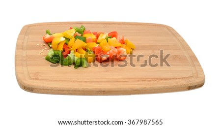 Colored capsicum or bell peppers on the cutting board. Food background. - stock photo