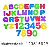 Colored card with letters of alphabet -multicolored plastic letters - stock photo