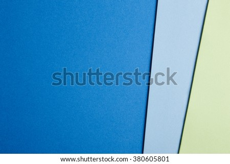 Colored cardboards background in blue and green tone. Copy space. Horizontal