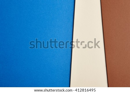 Colored cardboards background in blue beige brown tone. Copy space. Horizontal