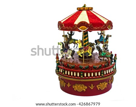Colored carousel toy with horses, close up, isolated