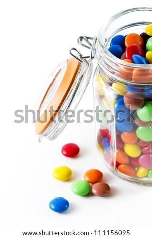 colored chocolate buttons in an old fashioned jar - stock photo