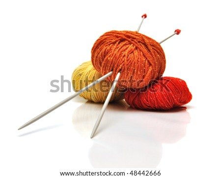 colored clews and knitting needles isolated on white - stock photo